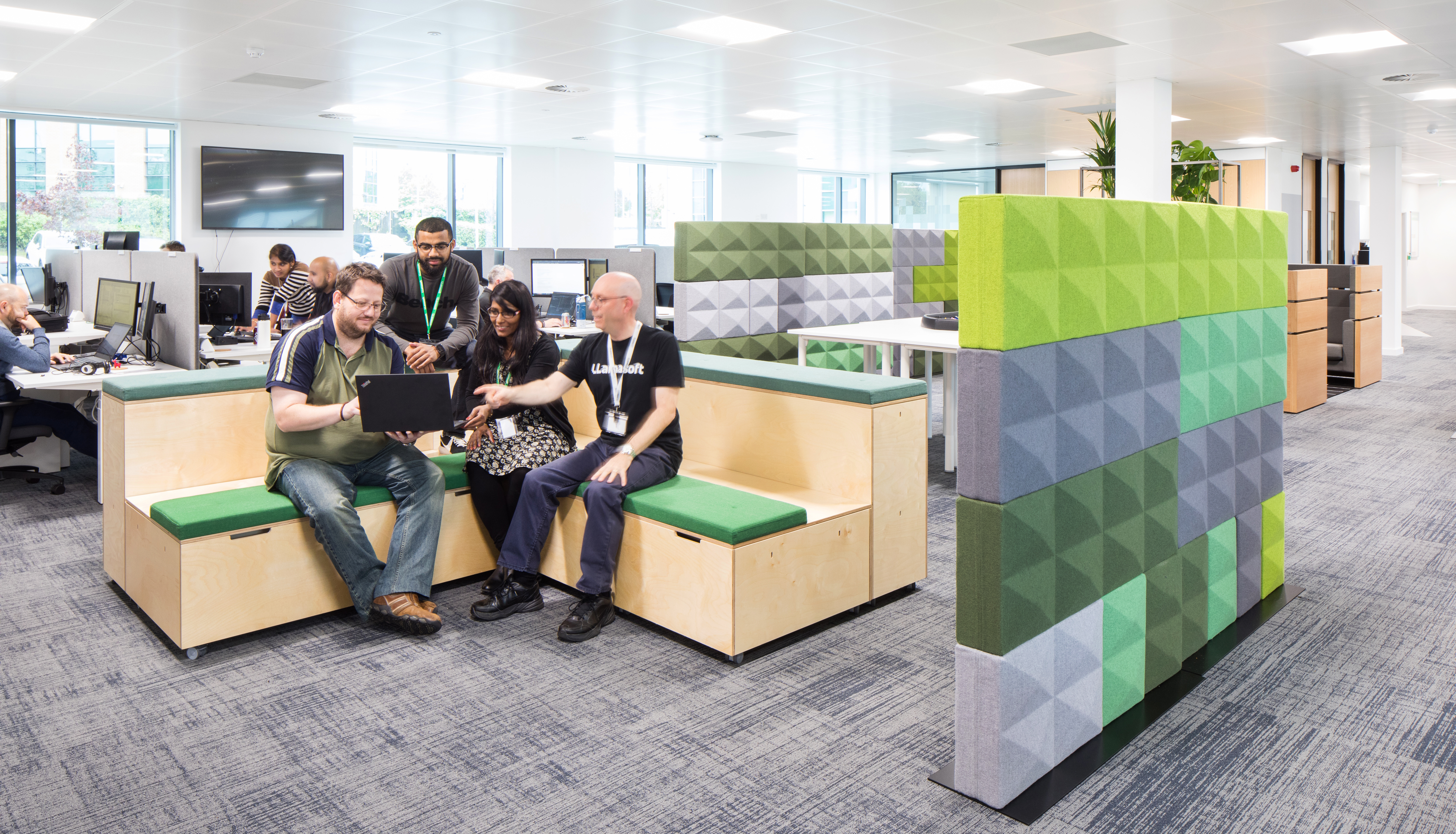 Team collaborating on seating area in office